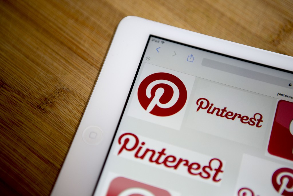 Pinterest Inc. logos are displayed for a photograph on an Apple Inc. iPad Air in Washington, D.C., U.S., on Thursday, Feb. 19, 2015. Pinterest Inc. the online scrapbooking company, is seeking to raise funding at a valuation of about $11 billion, according to a person familiar with the matter, continuing the soaring values of a group of high-profile technology startups. Photographer: Andrew Harrer/Bloomberg via Getty Images
